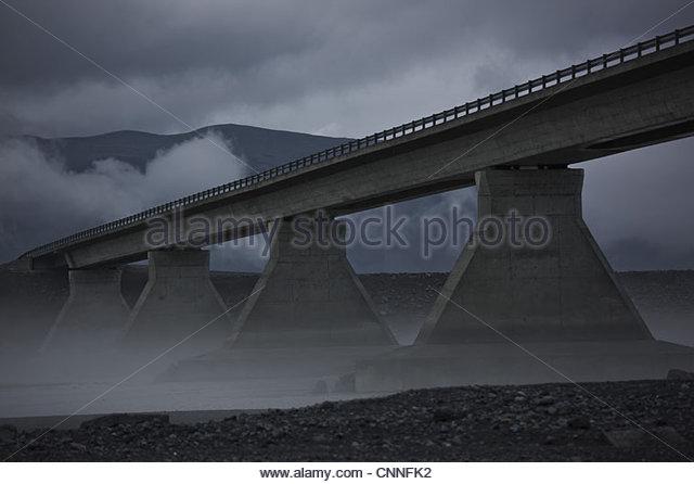 Bridge cloaked in fog - Stock Image