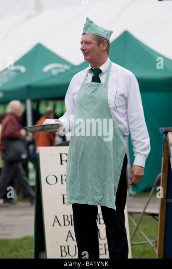 Man offering plate of food samples Food festival Ludlow Shropshire England UK - Stock Image