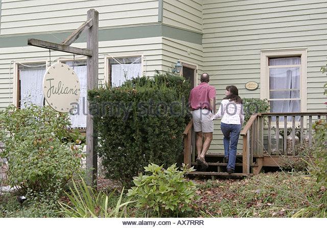 West Virginia Lewisburg Julian's Restaurant couple entering - Stock Image