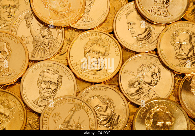 Layer of gold one dollar U.S. Presidential coins - Stock Image