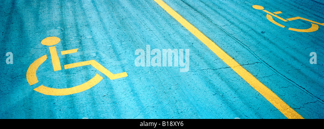 painted handicap sign on a parking spot, Montreal, Quebec, Canada. - Stock Image