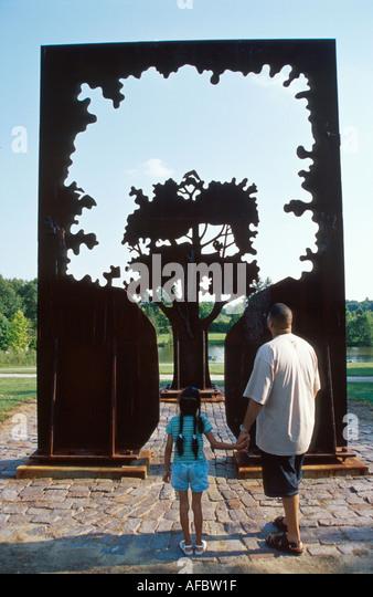 Toledo Ohio Botanical Garden sculpture representing tree visitors - Stock Image