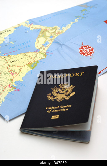 A United States Passport and a folded map of Bermuda illustrate the concept of travel. - Stock-Bilder