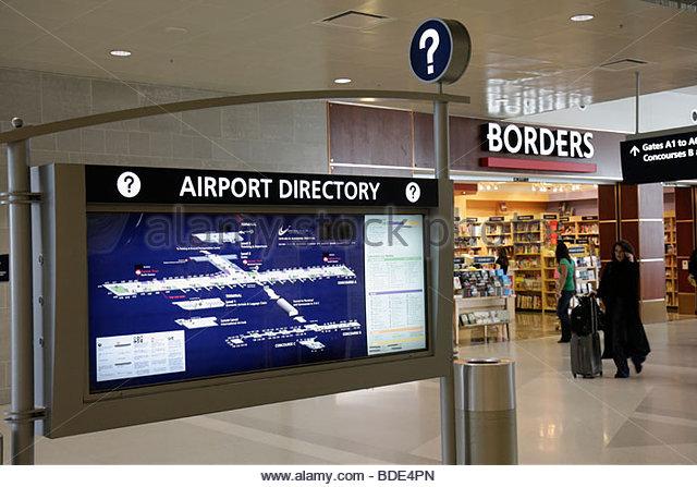Michigan Detroit DTW Detroit Metropolitan Wayne County Airport transportation terminal gate arrival departure concourse - Stock Image