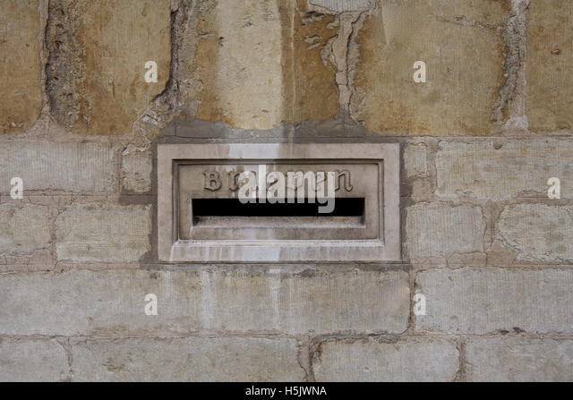 Brugge post box in marble, part of a church building, Belgium - Stock Image