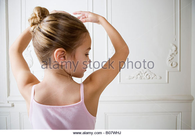 Young girl performing a ballet move - Stock Image