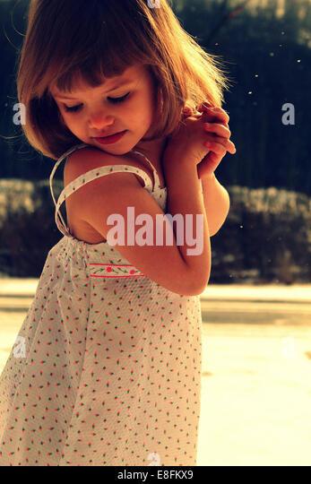 Little girl in summer dress - Stock Image