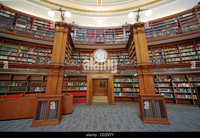 Clock over door to Honby library, Liverpool central library Picton reading rooms - Stock Image