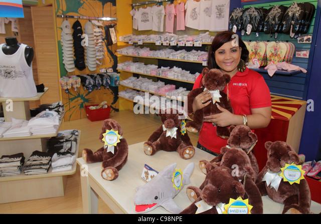 Curaçao Netherlands Antilles Dutch Willemstad Otrobanda Riffort shopping mall gift shop souvenirs woman salesclerk - Stock Image