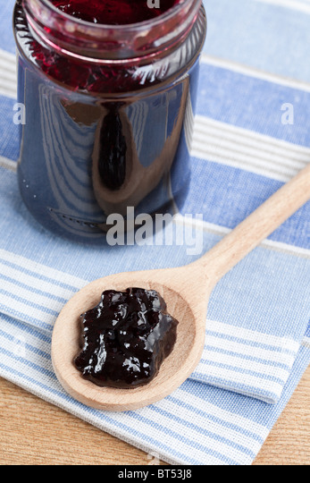 fruity jam in glass jar - Stock Image