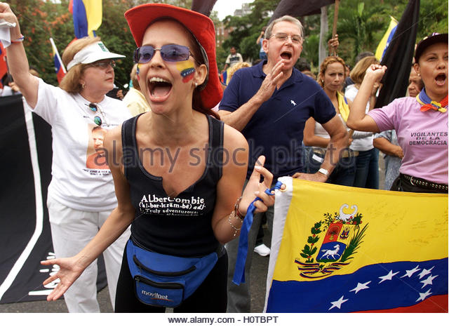 Venezuelans protest near the Cuban Embassy in Caracas, April 18, 2003.  Venezuelan national guard troops blocked - Stock Image
