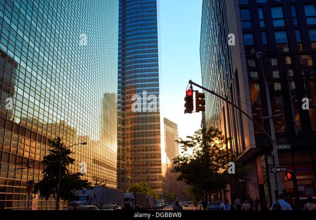 Sunset reflecting off of glass buildings in Lower Manhattan, New York City - Stock Image