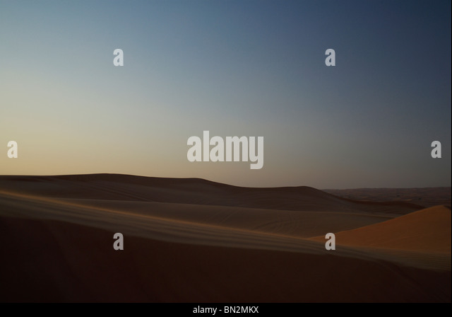Sand dunes in evening light, Dubai - Stock Image