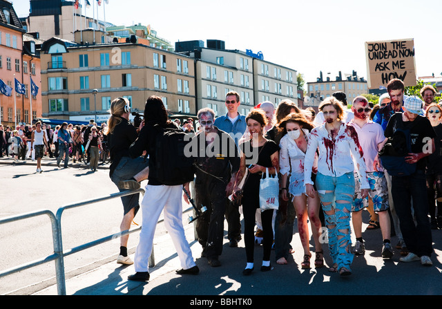 People dressed up as zombies and walking through Stockholm on the 30th of May 2009 during horror masquerade event - Stock Image