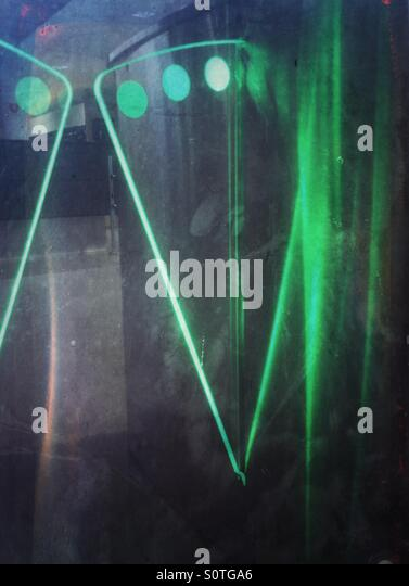 Green lights reflected in stainless steal at an entry gate. - Stock Image