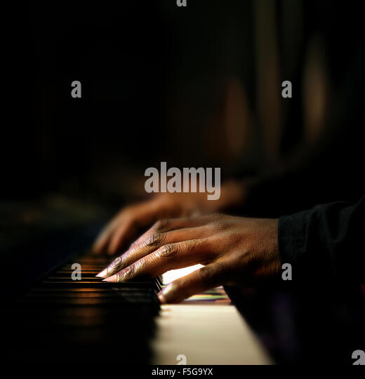 Hands of pianist playing synthesizer close-up - Stock Image