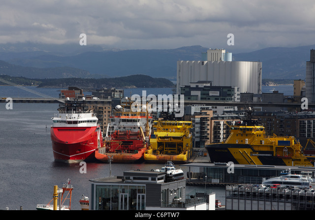 Anchor handling and offshore service vessels, including KL Saltfjord and Njord Viking, moored in the Port of Stavanger, - Stock Image