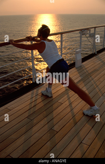 Bahamas Atlantic Ocean Holland America Line ms Maasdam cruise ship man stretches runner sunrise - Stock Image