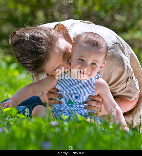 Mother and child outdoors. Motherhood concept - Stock Image