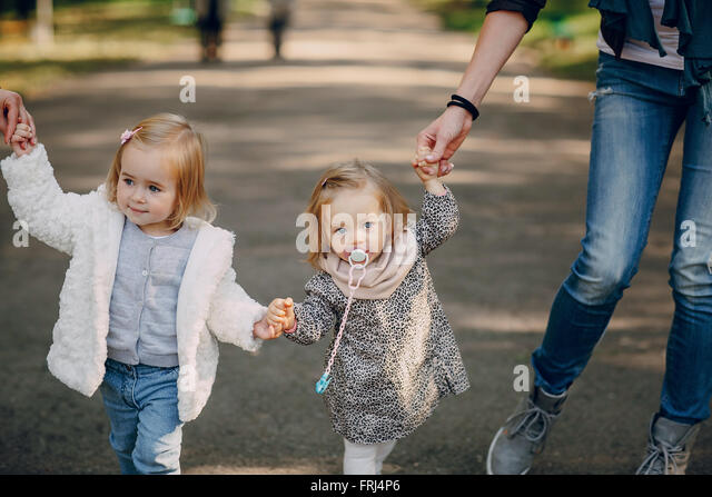 young family walking in the park - Stock Image