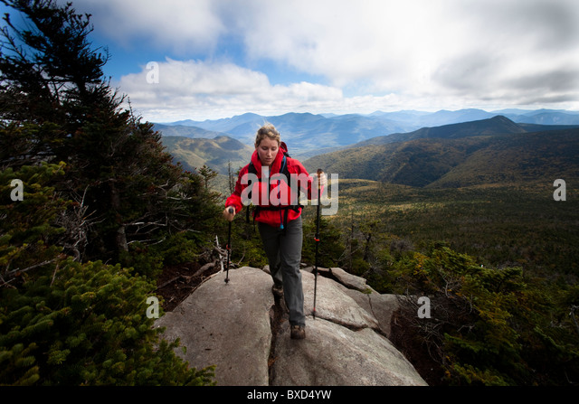 An athletic female hikes the Franconia Ridge Trail. - Stock Image