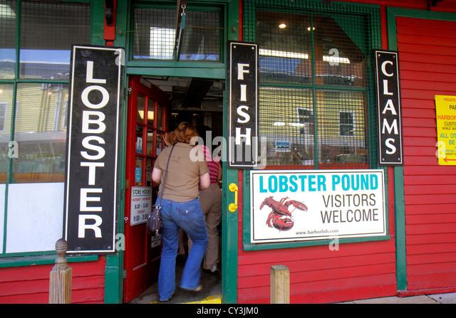 Portland Maine Historic Old Port District Custom House Wharf Harbor Fish Market front entrance customers enter - Stock Image