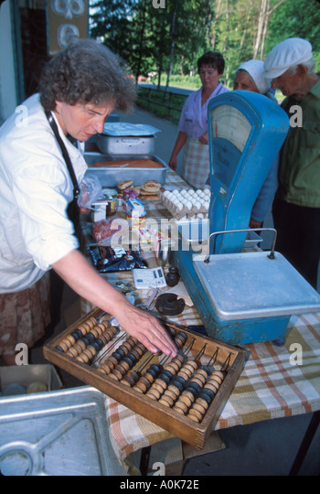 Russia former Soviet Union Uglich sidewalk food vendor using abacus - Stock Image