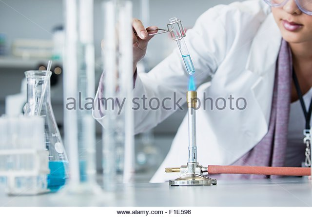 Lab worker heating up sample - Stock Image