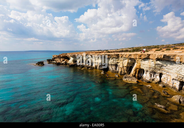 Sea caves and turquoise water at Cape Greco. Cyprus - Stock Image
