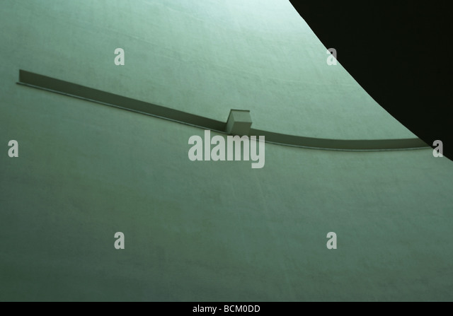 Interior architectural shot, low angle view of concrete wall - Stock Image