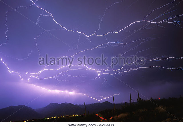 Horizontal Lightning over Mountains in  Tucson Arizona from huge thunderstorm  complex. - Stock Image