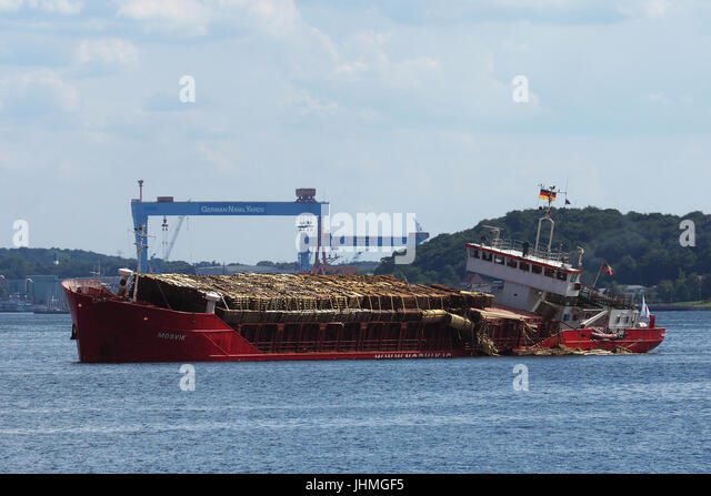 Kiel, Germany. 14th July, 2017. Genereal Cargo vessel Mosvik lost part of it`s wood-cargo while heading for the - Stock Image