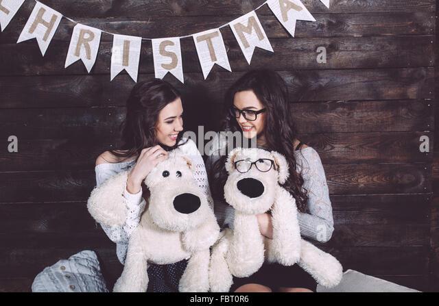 Two charming girls playing - Stock-Bilder