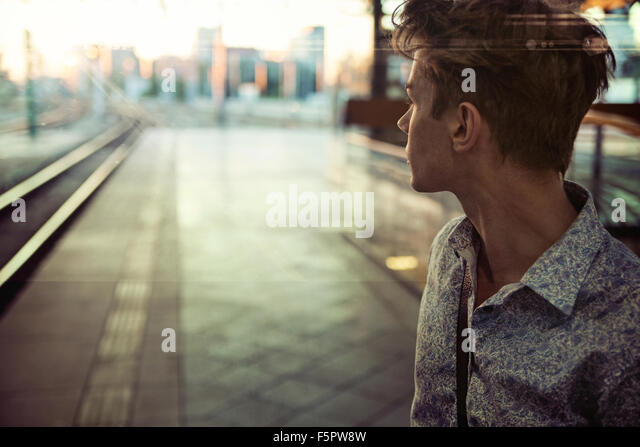Calm guy in the retro railway station - Stock Image