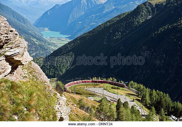 Mountain train at Alp Gruem train station, with the Valposchiavo in the background, Engadin, Switzerland. - Stock-Bilder