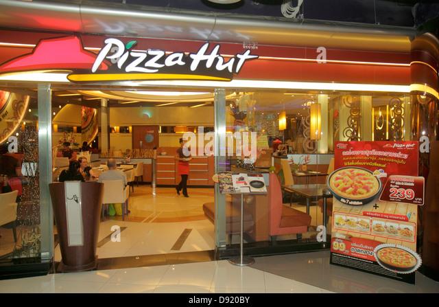 Bangkok Thailand Pathum Wan Rama 1 Road MBK Center centre complex mall shopping restaurant Pizza Hut front entrance - Stock Image