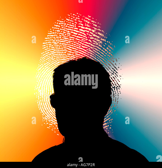 silhouette of man looking at finger print of large screen - Stock Image