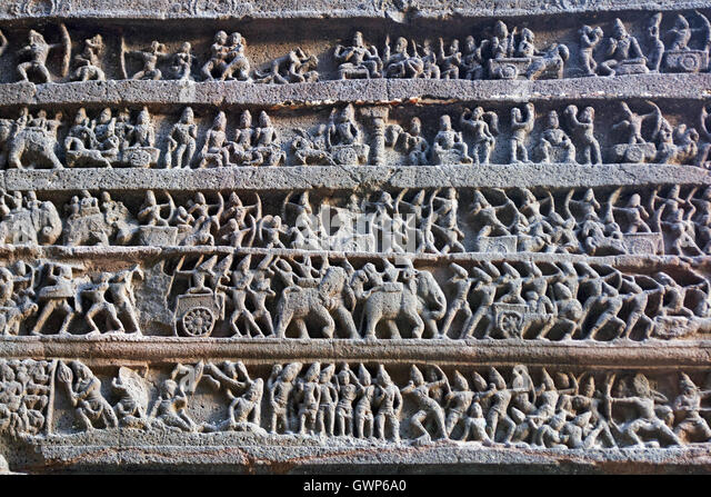 Hindu religious story carved into the rock face at the ancient Hindu Temple (Kailas Temple). Ellora Caves, India. - Stock Image
