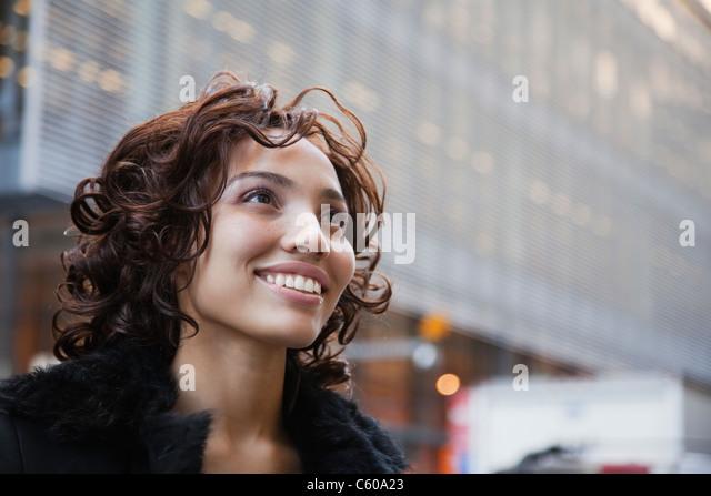USA, New York, New York City, portrait of smiling woman on street - Stock Image
