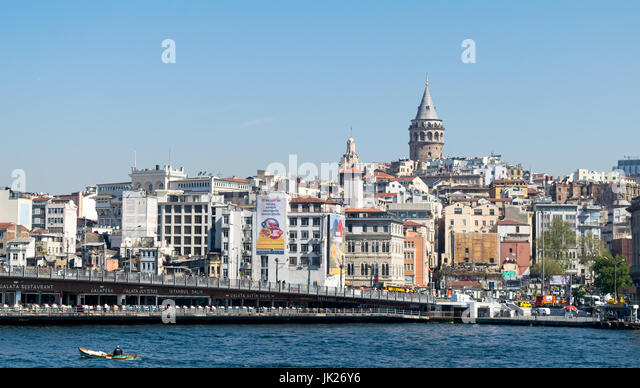 Istanbul, Turkey - April 26, 2017: City view of Istanbul, Turkey overlooking Galata Bridge with traditional fish - Stock Image