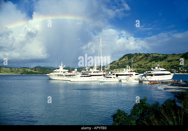Antigua Luxury Powerboats at Anchor with Rainbow overhead - Stock Image