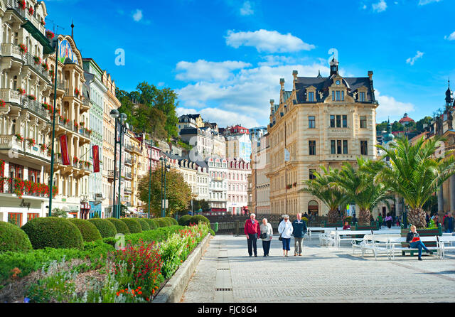 People walking along Hot springs colonnade in Karlovy Vary. - Stock-Bilder
