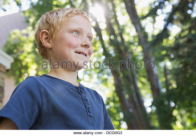 Portrait of little boy outdoors - Stock Image