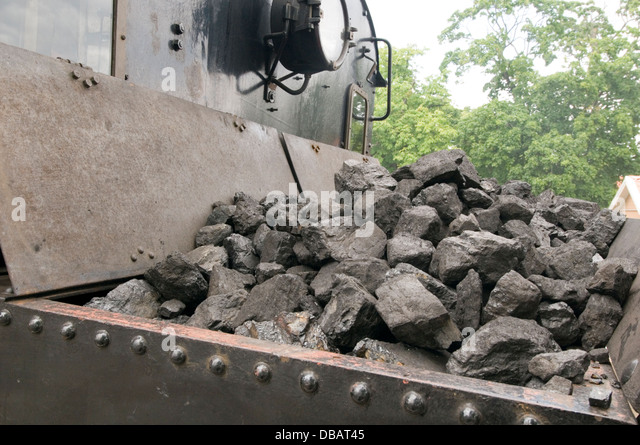 coal box train lump of lumps steam trains fossil fuel fuels - Stock Image