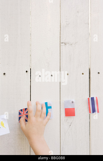 Childs hand and flags - Stock-Bilder