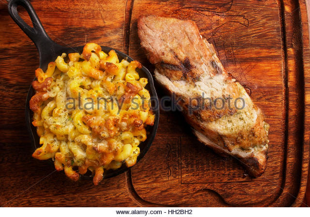 Grilled pork tenderloin with mac and cheese - Stock Image