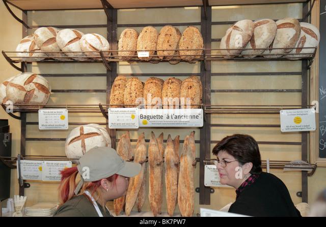 Washington DC Eastern Market 7th Street NE bakery artisan bread crafted hand-shaped baguette counter clerk customer - Stock Image