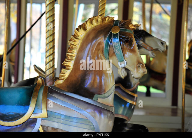 Children's roundabout, nostalgic carousel with wooden horses from 1910, Congress Park, Saratoga Springs, New - Stock Image