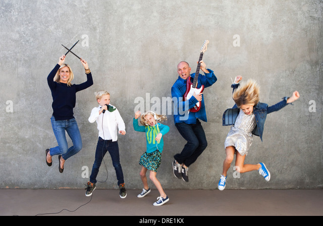 Family rocking out - Stock-Bilder