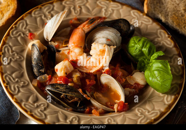 Homemade Italian Seafood Cioppino with Mussels, Clams, and Shrimps - Stock Image